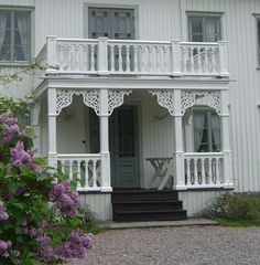 Swedish white farmhouse with pretty porch