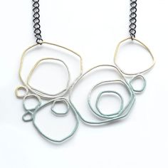Ombre Circle Necklace Slate by Studio METHOD(E) ... Studio METHOD(E) Candy-Colored Jewelry For Spring With a fresh approach to jewelry-making, Studio METHOD(E) masterfully combines recycled copper wire and powder-coating to create a line of dramatic statement pieces.