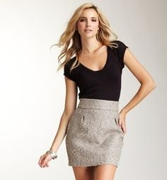 black v-neck tee with a tweed skirt