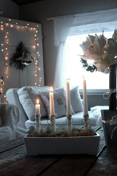 When we lived in Winston-Salem NC, I grew to love the Moravian tradition of the white lights at Christmas. This reminds me of that time, serene and simple warmth, notice the hearts around the candles...
