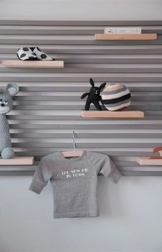 Mandal wall mounted headboard from Ikea used as a shelving system