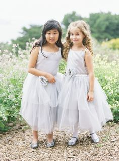 Two lovely best friends as flower girls