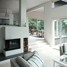 Split Level - four steps. Fireplace serves as a connection / boundary between.  #boundary #connection #fireplace #level #serves #split #steps