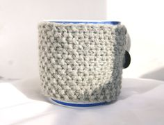 Hand knitted light grey cup cozy with black button
