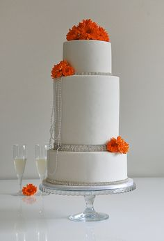 Wedding cake themed for bride who loved gerbera's, pearls and diamonds.