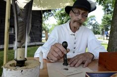 Phil Colarusso, Commander of the Albany Militia seals a letter with wax at the encampment at the Blockhouse in Stillwater . (Mike McMahon / The Record) Life Video, Fortification, Seals, Wax, Letter, Bring It On, Seal, Letters, Laundry