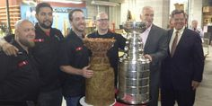 """Philip Pritchard @ keeperofthecup tweeted this photo of Blackhawks coach Joel Quenneville and chairman Rocky Wirtz with the Stanley Cup and an edible Stanley Cup:  """"Rocky and Coach Q with the #StanleyCup while a cup made from bacon and meat loaf looks jealous!"""""""