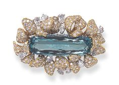 AN AQUAMARINE AND DIAMOND BROOCH Centering upon a modified oval-cut aquamarine, within a pavé-set diamond and gold foliate frame, enhanced by pear-shaped diamonds, mounted in 18k white and yellow gold