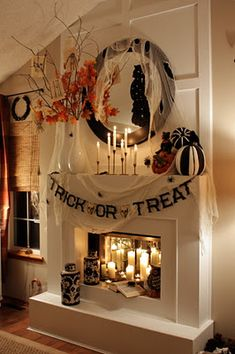 I'm not into Halloween but this looks great.  I love the mirrored tiles hot glued onto the walls inside the non-working fireplace which reflect the candles beautifully!!  Great idea!
