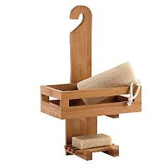 Wooden shower caddy with tray and soap shelf.