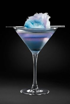 Cotton Candy Swirl Cocktail  W/ cotton candy vodka, St-Germain, cranberry juice, & cotton candy