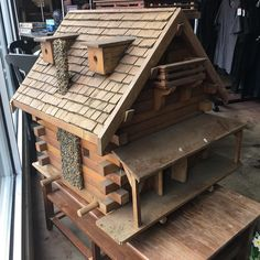 Amazing hand-made folk art birdhouse about 3' x 3' at the Capitol Hill Goodwill store.