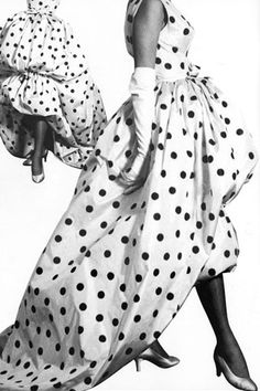 Balenciaga introduced this white taffeta peacock-tail evening dress with black dots in spring 1958. The dress features a bunched skirt, inspired by a Spanish gypsy costume.
