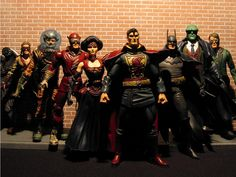 JLA by Gaslight (l to r): Hawkgirl, Aquaman, The Flash, Wonder Woman, Superman, Batman, Martian Manhunter, Green Lantern.