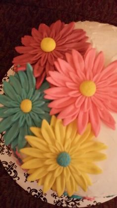 Fondant Gerber Daisy flowers I am planning on making these for Aurora's 1st birthday cake :D