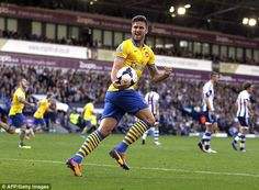 Olivier Giroud celebrates Arsenal's equalizer against West Bromwich Albion.