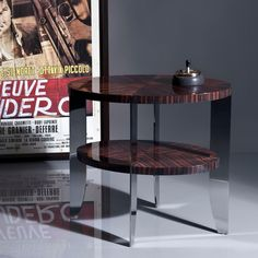 Eclipse, side table. Natural glossy macassar top and polished stainless steel base. Designed By: GAMA~Georges Amatoury