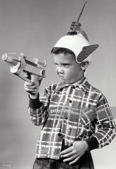c. 1950s BOY WITH ATOMIC TOY GUN, HAT WITH WINGS