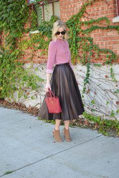 burgundy pleated leather midi skirt, patterned red top, red bag, karen walker sunglasses