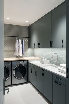 This laundry room uses a creative, neutral color palette to achieve its high-impact, minimalist aesthetic.