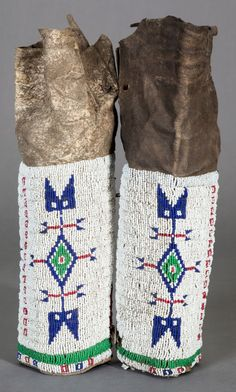 A PAIR OF SIOUX GIRL'S BEADED HIDE LEGGINGS... American Indian | Lot #54429 | Heritage Auctions