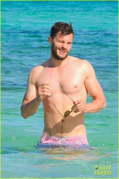 jamie dornan shirtless on the beach 01 Jamie Dornan puts his sexy shirtless body on display while on vacation in Ibiza, Spain on Saturday (September 19).    The 33-year-old Fifty Shades of Grey star dove…