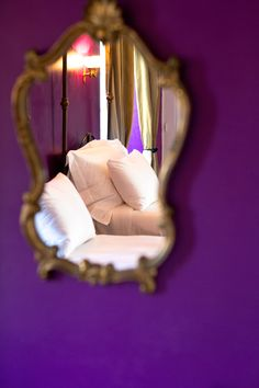 Purple Walls through mirror in Purple & Gold Chateau Bed Room. www.chateaurobertfrance.fr