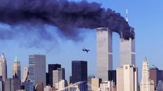 30 pictures of 9/11 that show you why you should never forget ----As smoke billows from the north tower, the second hijacked plane bears down on the south tower