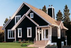 A multiple-gabled roof and a covered entry give this vacation home a charming appearance.  House plan #181126
