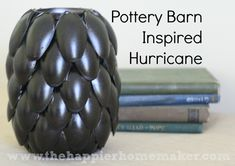 oil rubbed bronze pottery barn inspired hurricane-made from what??  PLASTIC SPOONS.  It looks like spraypainted plastic spoons to me.