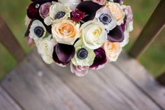 Bridal bouquet with roses, calla lilies, anemones, ranunculus, and scabiosa.  Vintage inspired bouquet.  Purples and creams.  www.pennypackweddings.com  Pennypack Flowers.