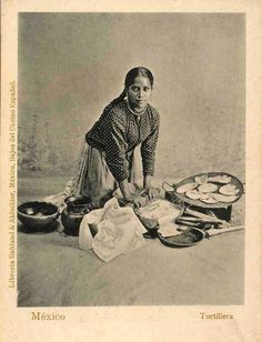 This old Mexican postcard (which has no vertical line on the reverse) shows a woman making tortillas using a metate and a comal for cooking.