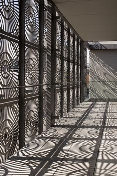 Herbst Architects. Love the idea of putting grates in front of existing windows for a similar effect. Hang from ceiling on a window you don't plan to open much. The shadows are gorgeous!