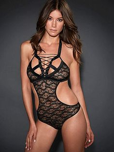 NEW Tie-Up Lace Teddy - Cutting-edge and come-hither, this ultra-sexy teddy flaunts a Parisian flair. Stunning features include: <ul>    <li>Gorgeous lace body with cutouts</li>    <li>Lace-up detail with grommets at the chest</li>    <li>Halter style</li>    <li>Polyester/spandex</li>    <li>Imported</li> </ul> Add our Solid Band Fishnet Thigh High for your hottest look ever.