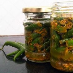 Green chili pickle (hare mirch ka achar) - step-by-step recipe with pictures. Plus tips for making homemade pickles. Paneer Recipes, Indian Food Recipes, Vegetarian Recipes, Veg Recipes, Recipies, Green Chilli Pickle, Chilli Pickle Recipe, How To Make Chilli, Easy Cooking