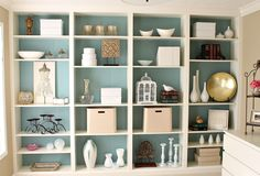 shelf decorating. love the color in the back. Library?  billy bookshelves