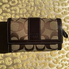 Brand New Coach Wallet with tags Brand new with tags! Coach signature compact wallet in Khaki/Chestnut color. Timeless and the perfect size to fit cash, credit cards and change.  60% off original retail price! Offers welcome :) Coach Bags Wallets