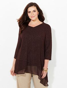 Our stylish top features allover metallic stitching that drifts over the textured, stretch fabric. A sheer inset at the hem adds interest and creates a flowing finish. V-neckline. Three-quarter sleeves. Asymmetrical hem that is longer on one side. Catherines tops are perfectly proportioned for the plus size woman. catherines.com
