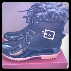 Black Fur Duck Boots Fleece lined for comfort! Zips on the inside so you don't have to tie them every time! Waterproof patent look rubber lower, man made upper. Very comfortable. Made by Nature Breeze. True to size. Shoes Winter & Rain Boots