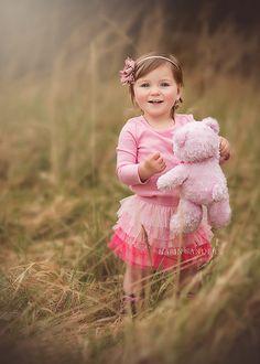 A little girl & her pink Teddy.
