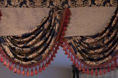 Feast your eyes upon the decadence and regality of this luxurious black valance drape set. This sumptuous piece features asymmetric swags outlined with red tassel fringes. Make a statement with this unique and impressive window treatment. Fancy Curtains, Elegant Curtains, Cotton Curtains, Drapes Curtains, Drapery, Black Pillow Cases, Swags And Tails, Living Room Drapes, Window Styles
