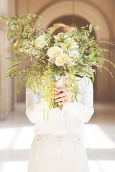 A City Hall Wedding We Can't Stop Looking At #refinery29  http://www.refinery29.com/san-francisco-city-hall-wedding#slide-5  How gorgeous is her natural, overgrown bouquet? The flowers came from a Fresno florist, but Eaton tweaked the arrangement by adding her own greens from the farmers' market.