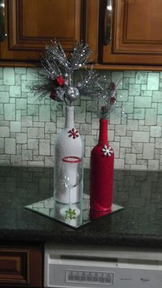 Painted wine bottles and glass