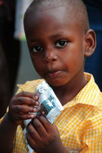 Plumpy'Nut® is a ready-to-use therapeutic food, endorsed by the World Health Organization and UNICEF, and is proven to treat severe acute malnutrition with astounding success rates. It is an energy-dense paste made with peanuts, milk powder, sugar, vegetable oils, and a fortified vitamin and mineral mixture.  In 4-10 weeks, a child can be transformed from near death to certain survival. With its 2-year shelf life, this simple solution can reach even the most remote areas