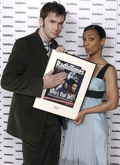 David Tennant and Freema Agyeman... DT covers up his face so one can pay Freema the right kind of attention, what a Gentleman