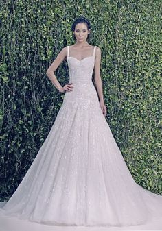 ZUHAIR MURAD Sweetheart Neckline A-Line Wedding Dress in Tulle A sweetheart neckline wedding dress in A-line silhouette with beaded embroidery and sequins on the bodice cascading to the skirt with straps. It has a chapel train.