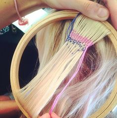 Hair Is Placed in a Needlepoint Frame