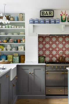A patterned tile splashback and soft grey cupboards - deVOL Kitchens