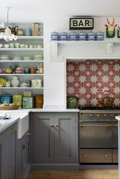 A patterned tile splashback and soft grey cupboards - deVOL Kitchens