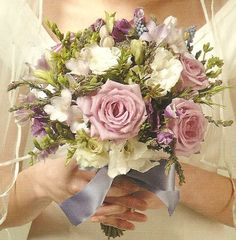 interesting+prom+bouquets | this light purple rose bouquet was done with blue curiosa